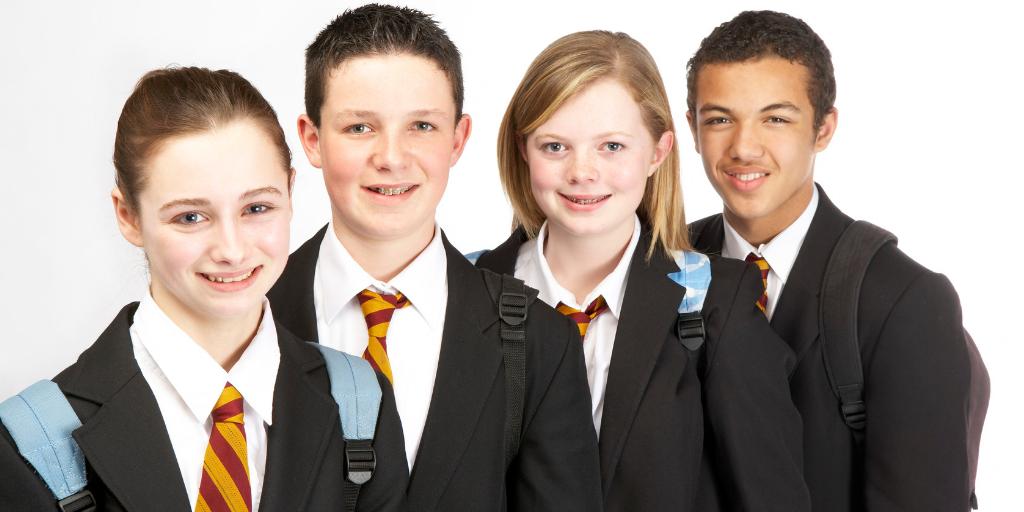 Four students wearing school uniforms